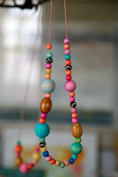 Despite the fact that I own twelventytwo thousand necklaces, I want more. Specifically, I want a bunch of these trendish-y bohemian summer, extra long wooden bead and tassel necklaces that are everywhere, but nowhere that I can find. I keep seeing metal versions in the store but who wants a metal chain around their neck …