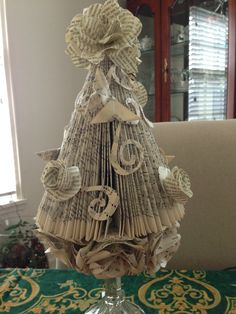 """I wanted something I could keep out all year long. To embellish my folded tree, I made origami butterflies and several different flowers from tutorials on my """"Book Art Tutorial"""" board."""