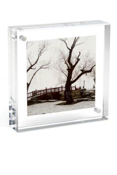 """It is made of two thick panels of clear, solid acrylic which are held together by tiny magnet points. Place your picture between them and whoa!..expert framing without all the hardware. Float your photos in the center of the frame for a cool acrylic border.    Measures 6""""H x 6""""W x 1-1/8""""D.    Acrylic 6x6 Frame by Canetti. Home & Gifts - Home Decor - Frames Lambertville, New Jersey"""