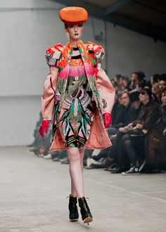 manish arora the color are amazing and fun and a great expressiue piece with the perfect simple but colorful hat and basic black shoe.
