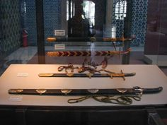 al-Rasub  The al-Rasub sword is one of the nine swords of the prophet Muhammad. It is said that the weapons of the house of the prophet Muhammad were kept among his family just like the Ark was kept with the Israelites.  The sword is preserved in the Topkapi museum, Istanbul. Its blade is 140 cm in length. It has gold circles on which are inscribed the name of Ja'far al-Sadiq. Photograph taken from Muhammad Hasan Muhammad al-Tihami, Suyuf al-Rasul wa 'uddah harbi-hi (Cairo: Hijr, 1312/1992).