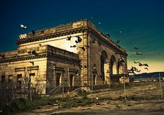 """""""Abandoned Oakland Railway Station ~Pigeons~"""" -- [16th & Wood Streets - West Oakland, Alameda County, California. Designed by architect Jarvis Hunt who was preeminent train station architect at that time. The station opened August 1 1912. For many decades the station was a major railroad station of the Southern Pacific railroad in Oakland. In 1989 it closed down due to major damage from the 1989 Loma Prieta earthquake.]~[Photograph by tibchris (Chris Willis) - January 12 2010]'h4d-48.2013'"""