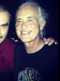Jimmy Page with a fan in Dubai May 28, 2014 at a Kings Of Leon Concert