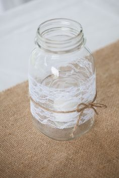 Lace Mason Jars - Decor- doing this for my reception tables! And using ribbon instead of twine :)