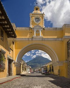 Antigua, Guatemala. Beautiful colonial town at the foot of a volcano, sometimes hit by earthquakes-totally worth the possible thrill of ground shaking.