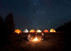 glowing tents and bon fire