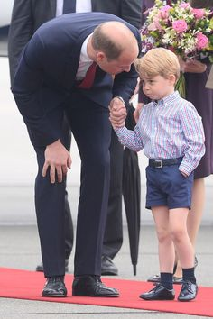 Prince George looked pouty in Poland when he landed on Monday.