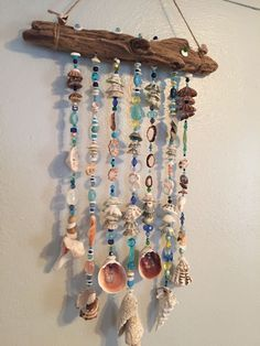 soft blue beads are perfect with shells - DIY Jewelry Crafts Ideen Seashell Wind Chimes, Diy Wind Chimes, Seashell Art, Seashell Crafts, Beach Crafts, Diy And Crafts, Arts And Crafts, Driftwood Mobile, Driftwood Art