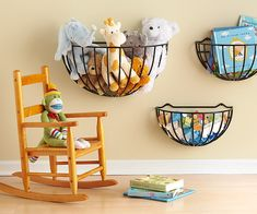 Fun idea!!!  Storage Solution from the Garden -  Baskets designed to hold lush flowers and plantings find a new purpose in a kid's room. The baskets, typically seen on porch and deck rails, mount flush to the wall and are ideal for holding favorite toys and books. Install the baskets within reach of little ones, so pickup is a breeze. (Great idea for all the stuffed animals)