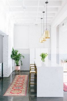 all-white kitchen + metallic accents xxx