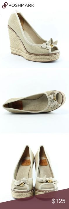 Tory Burch wedge NIB sz 10M The Jacki Wedge combines natural canvas with rustic braided jute. Its flattering peep-toe design is both feminine and sturdy, finished with a tonal grosgrain hoe and a dangling double-T logo charm. Shimmering material Tory Burch Shoes Wedges