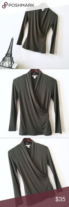 NWOT Banana Republic Draped Olive Sweater Top XSP NWOT Banana Republic Draped Olive Sweater Top XSP. Brand new and never worn. Took the tags off when I bought it but have the same top in gray and I never got around to wearing this one so it has to go. I can only imagine how sexy this top would be with leather leggings though. Super soft material. Banana Republic Tops Tees - Long Sleeve