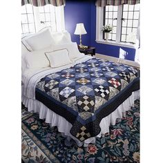 Checkerboard Quilt-A striking blue toile surrounds square-within-a-square blocks set on point to create this timeless quilting project.