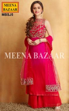 Georgette Magenta Sharara Suit -  Transform yourself into a princess with this Magenta & Red Georgette Sharara Suit adorned with Dori and Sequins work on the Yoke. Its paired with Matching Red Sharara and a Magenta Net Dupatta embellished with similar Dori and Sequins work on the border as the Kameez. Saworski Crystals are sprinkled all over the Dupattta making it stunning and vivascious to the extent of creating magic. There's a sense of Royal elegance to this sprucely embelished suit.