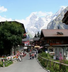 Murren, Switzerland-only accessible by train or cable car-population 450. The Lauterbrunnen Valley below is possibly the most beautiful scenic place in the world.