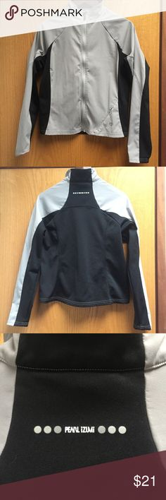 Pearl Izumi softshell hybrid bicycle jacket M Pearl Izumi softshell hybrid bicycle jacket , grey material is a very lightweight softshell style, black material is a fleece with fuzzy in the inside and flatlock smooth stitch on the outside. Size women's Medium but fits more like a small. Excellent condition. Pearl Izumi Jackets & Coats