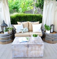 Cozy small backyard decor idea. Love the barrel planters / end tables! - Doing this!!!!