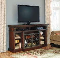 """Alymere II collection traditional style rustic brown finish wood large tv stand. TV stand measures 72"""" x 19"""" D x 39"""" H. Some assembly required."""