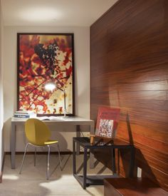 Wood wall.   A reverse view of the media room shows a Key square extending table, Element side table, a Basil desk chair in mustard yellow and Materic...