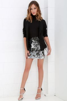 Lulus Exclusive! With a look as irresistible as a siren's song, a sea of compliments will follow you and the Sequin Siren Silver and Black Sequin Skirt! This dazzling mini skirt sits high at the waist, while the woven fabric falls to a sassy mini length. Black sequins with silver backs create a unique two-tone effect. Exposed silver back zipper.