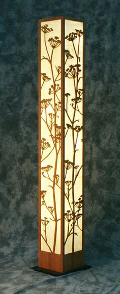 Wild Fennel Floor Lamp. Our decorative laser cut wood floor lamp can transform a room. In Sonoma County, this plant is commonly found growing wild. The plant has strong geometric branching, and delicate flowers. (Original artwork by Ron Macken). Light is diffused by hand made paper and lit by a 9 watt compact fluorescent bulb.