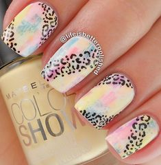 Colorful leopard nail art design. The background of the nail art is done in a paintbrush fashion which gives off light colors that are pleasing to the eyes. The leopard prints are also painted on top as if dancing along the explosion of colors.