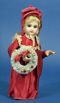 One-of-a-kind  EJ Jumeau Candy Container #30115  10-inch Candy Container with bisque head, paper-weight eyes, mohair curls.  Dressed in antique cerise satin dress and cap trimmed with antique lace and  carrying a decorated bottle brush Christmas wreath.  $395.