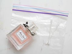 Spray cotton swabs with your perfume and hide them in sandwich bags inside your handbag for quick touch-ups throughout the day.
