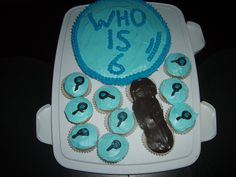 Spy themed birthday party.  The cake was a cupcake cake I made using a round pan that I placed cupcake liners in.  You fill the cupcakes up approx 3/4 of the way so when it bakes the tops bake together and you pull it apart.  I made the shape of a magnifying glass, and added mini magnifying glasses to the individual cupcakes