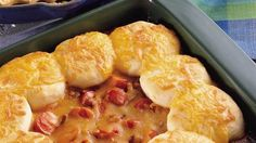 Bubbly casserole of hot dog slices and baked beans topped with biscuit rounds.