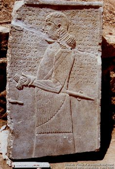 Nineveh. Portion of an inscribed late Assyrian relief found at the Nebi Yunus excavations, Mosul, Iraq. A eunuch in a procession or ceremony. Translation of inscription unknown. Probably 7th century BCE. Ruler is 20 cm. long. 4 June 1990.  It is not certain this orthostat was actually found at Nebi Yunus.