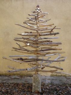 Wood twigs spray painted and arranged into a tree