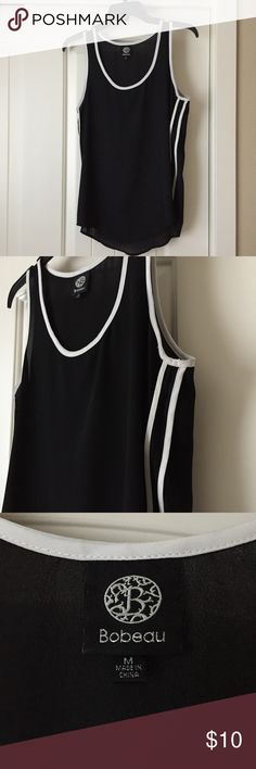 """Bobeau Black Tank Medium black Bobeau tank with white piping detail around the neck and arm holes as well as two stripes down both sides. Chiffon like material. Approximate length 26"""" bobeau Tops Tank Tops"""