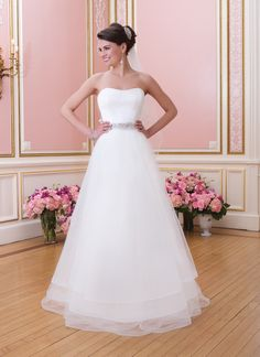 Sweetheart Gowns sweetheart style 6030 Satin fit and flare gown with modified sweetheart neckline features a  detachable tulle caged over skirt with sweep length train. Style  includes a beaded belt and buttons over the back zipper.