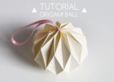 25. Diy origami ball. All Gorgeous! 50 DIY Paper Christmas Ornaments To Create With The Kids Tonight! Ranging difficulties and many would be wonderful to make and display anytime of the year!