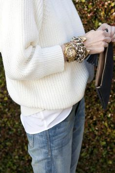 gold arm party, slouchy sweater