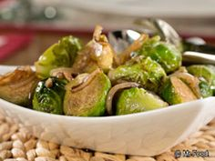 Balsamic-Glazed Brussels Sprouts  1 lb Brussels sprouts, trimmed, cut in half 1 T olive oil 1  onion thinly sliced 1/4  balsamic vinegar In a saucepan, bring 2 quarts water to a boil. Add Brussels sprouts and reduce heat to medium. Cook 20 minutes, or until sprouts are fork-tender and very green; drain.  In a medium skillet over medium heat, heat oil. Cook onion until tender. Add vinegar and sprouts. Stir to coat sprouts and cook until heated through.