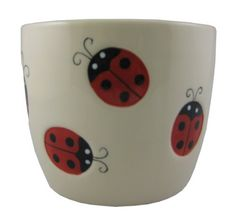 Napco 32101 5-Inch Tall Lady Bug Large Ceramic Cache Planter by Napco. $16.35. Glossy white ceramic planter pot or decorative vase with painted lady bug accents. Spruce up your garden, deck or patio outside or use as decorative ornamental accent inside. Made of quality ceramic for durability and long lasting beauty. Quality and classy home decor made easy. 5-inch tall with 5-1/4-inch diameter opening. Napco has built a uniquely innovative in-house design team. We ...
