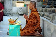 Monk praying at Mahabodhi Temple Complex, Bihar, India. Photograph by anthonyasael on Flickr