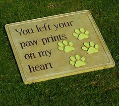 Touching garden tribute for a pet that has crossed over the rainbow bridge.