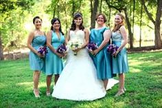 Teal Bridesmaid Dresses: Gave them a color range and let them pick any short dress they wanted so long as they could wear it again.  still LOVE my unique girls every time I see the photos.