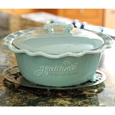 "Product # 83731 Grace & Gratitude Casserole Dish 11"" circumference, Height with lid is 6 1/2 gratitude, Our God we give you thanks. Ceramic. Holds 2 quarts. Oven, dishwasher, and microwave safe. www.myblessingsunlimited.net/mholleyjones"