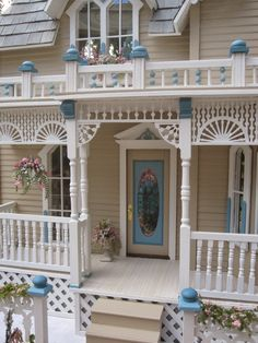 """This is """"The Darling House""""Victorian Dollhouse. This house is over the top with layers of white gingerbread from the lattice foundation t..."""