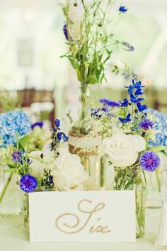 little flowers in jam jars for reception table and for church pews - also for ours we could add babys breath and some wee twigs