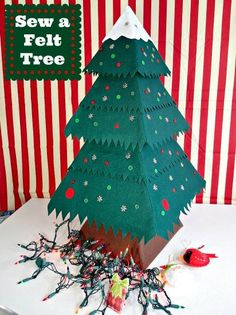 The cutest felt Christmas tree! It's the perfect size to go on an entry table or use as a table centerpiece. Learn how to make a felt Christmas tree! Christmas Tree Pattern, Felt Christmas Ornaments, Christmas Sewing, Christmas Tree Decorations, Christmas Diy, Toddler Christmas, Christmas Centerpieces, Xmas Tree, Christmas Makes