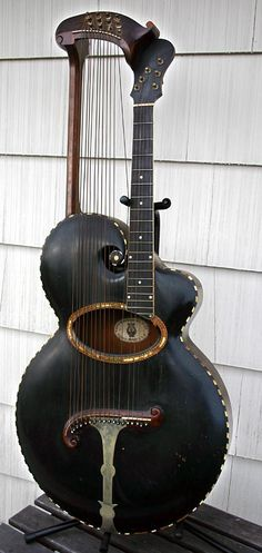 Vintage 1902~-903 Gibson Harp Guitar. I've actually never knew this was possible.