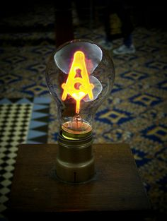 Masonic light bulb, containing square and compass logo. Mississauga Masonic Temple; Port Credit, Ontario. By Will.