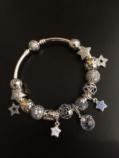 "PANDORA. All ""STAR"" Bangle. Featuring Star Dangles Charms and Clips!"