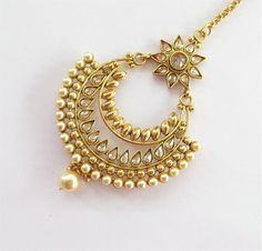 **Original Design by BeauteShoppe** This Listing is for: * Gold plated gold south indian tikka as shown in the pic. * Light Weighted. ~~ Length: