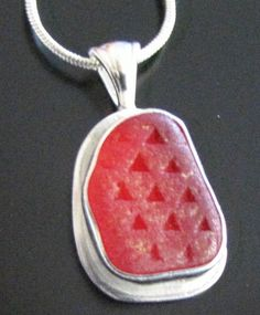 Red Sea Glass Necklace. This piece illuminates the faceted pattern that was common to car taillights, used to help light refract further.
